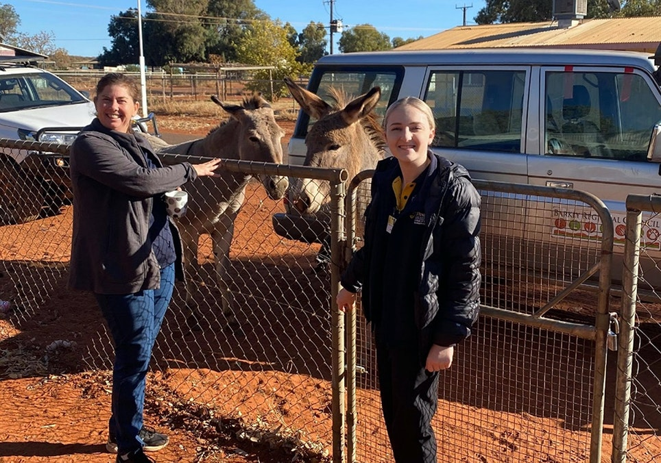 Jordyn Iovino and Kylie Adams Occupational Therapist Supervisor at the aged care clinic with wild donkeys in Ampilatwaja